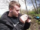 Kyle at Moorbridge Pond - finds a newt in a bottle whilst volunteering with our Amphibian & Reptile Survey
